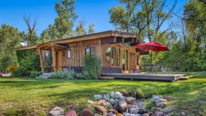 Colorado cabin with stream flowing in front.